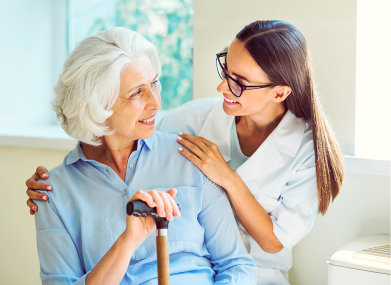 senior woman and caregiver with glasses