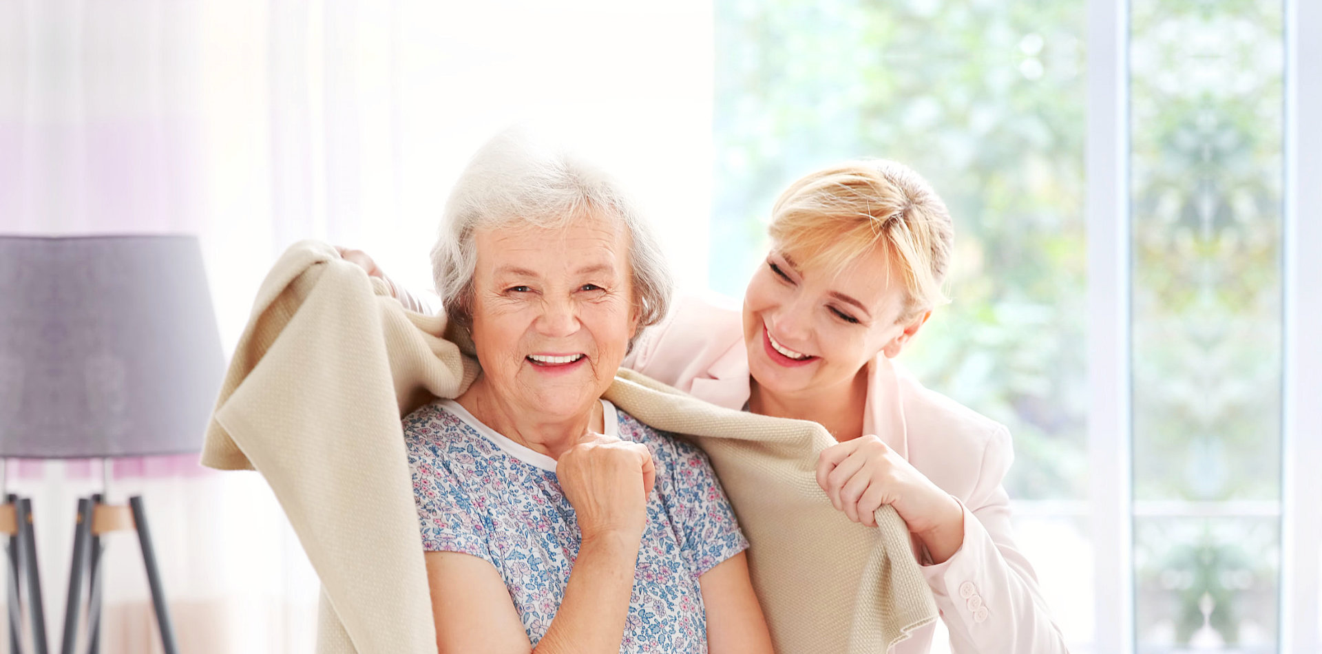 caregiver and senior woman having a great time